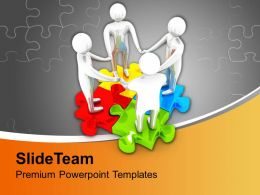 Team Joining Hands On Colorful Puzzle Powerpoint Templates Ppt Themes And Graphics 0213