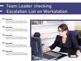 Team Leader Checking Escalation List On Workstation