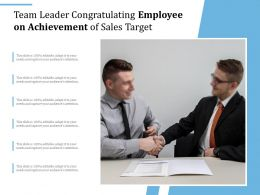 Team Leader Congratulating Employee On Achievement Of Sales Target