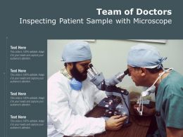 Team Of Doctors Inspecting Patient Sample With Microscope