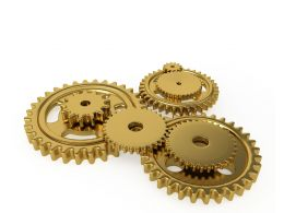 Team Of Golden Gears Working Together Stock Photo