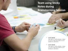 Team Using Sticky Notes During Brainstorming Session