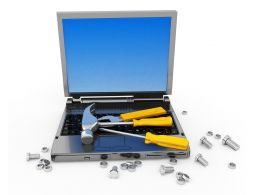 Technical Service Of Laptop With Hammer Screwdriver Nuts Stock Photo