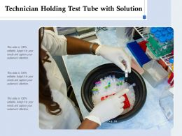 Technician Holding Test Tube With Solution