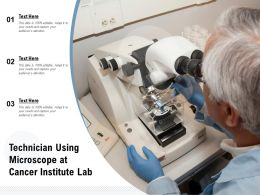 Technician Using Microscope At Cancer Institute Lab