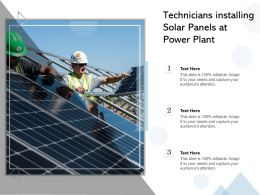 Technicians Installing Solar Panels At Power Plant