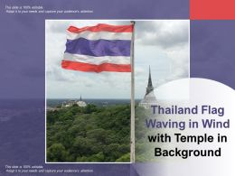 Thailand Flag Waving In Wind With Temple In Background