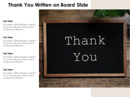 thank_you_written_on_board_slide_Slide01