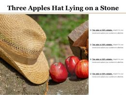Three Apples Hat Lying On A Stone