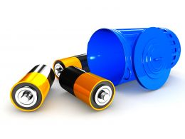 Three Batteries With Blue Recycle Bin Stock Photo