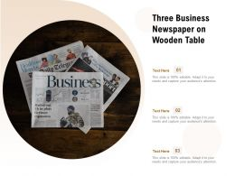 Three Business Newspaper On Wooden Table