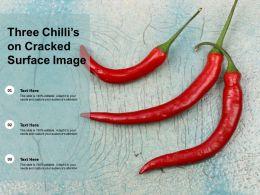 Three Chillis On Cracked Surface Image