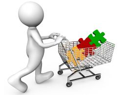 Three Colored Puzzle In Cart With 3D Man Stock Photo