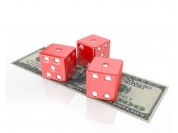Three Dices On Dollars Finance Stock Photo