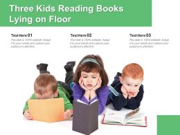 Three Kids Reading Books Lying On Floor
