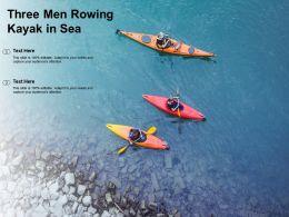 Three Men Rowing Kayak In Sea