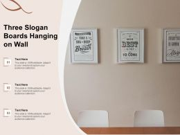 Three Slogan Boards Hanging On Wall