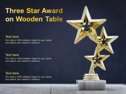 Three Star Award On Wooden Table