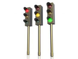 Three Traffic Lights With Red Green And Yellow Signals Stock Photo