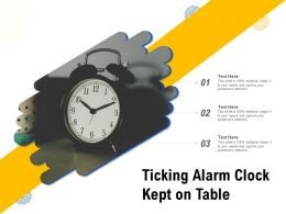 Ticking Alarm Clock Kept On Table
