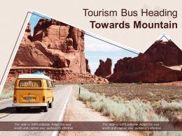 Tourism Bus Heading Towards Mountain