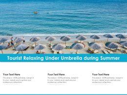 Tourist Relaxing Under Umbrella During Summer