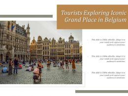 Tourists Exploring Iconic Grand Place In Belgium