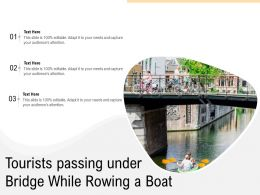 Tourists Passing Under Bridge While Rowing A Boat