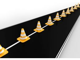 Traffic Cones On Roadmap For Business Stock Photo