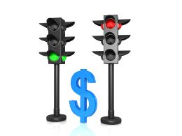 Traffic Lights With Red And Green Signals And Dollar Stock Photo