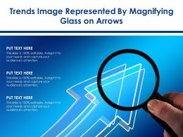 Trends Image Represented By Magnifying Glass On Arrows