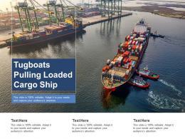 Tugboats Pulling Loaded Cargo Ship
