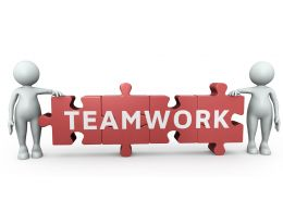 Two 3D Men With Teamwork Puzzle Stock Photo