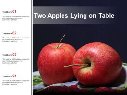 Two Apples Lying On Table