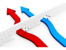 two_arrows_red_and_blue_colored_breaking_through_the_wall_stock_photo_Slide01