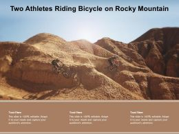 Two Athletes Riding Bicycle On Rocky Mountain