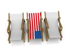 Two Beach Chairs With American Flag Stock Photo