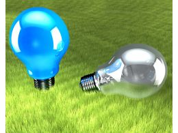Two Bulbs On Green Background Stock Photo