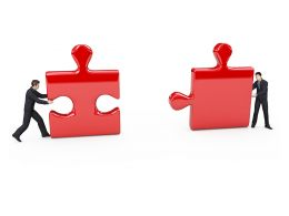 Two Business Men Holding Puzzle For Solution Building Stock Photo