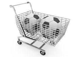 Two Footballs In Shopping Cart For Sales And Marketing Stock Photo