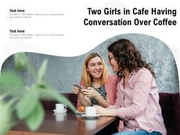 Two Girls In Cafe Having Conversation Over Coffee