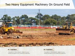 Two Heavy Equipment Machinery On Ground Field
