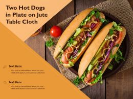 Two Hot Dogs In Plate On Jute Table Cloth