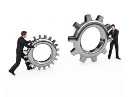 Two Man Holding Gears For Business Innovation Stock Photo