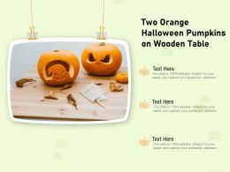 Two Orange Halloween Pumpkins On Wooden Table