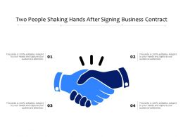 Two People Shaking Hands After Signing Business Contract