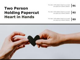 Two Person Holding Papercut Heart In Hands