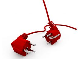 Two Red Plugs For Business Concepts Stock Photo