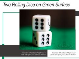 Two Rolling Dice On Green Surface