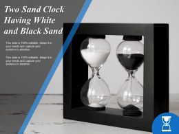Two Sand Clock Having White And Black Sand